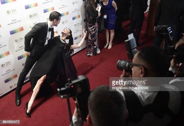 Ballerina Stella Abrera and her husband arrive for the 40th Annual Kennedy Center Honors in Washington DC on December 3 2017 / AFP PHOTO / Brendan...