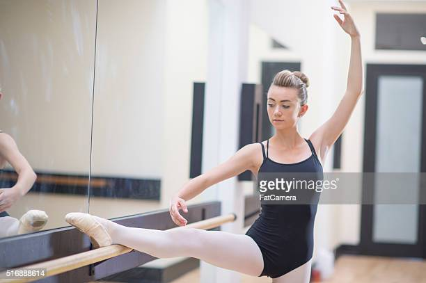 ballerina stretching on a barre - women wearing pantyhose stock photos and pictures