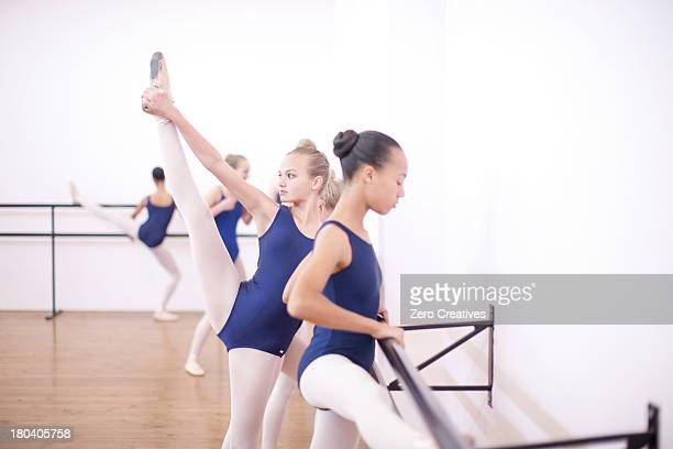 ballerina warming up at the barre - teen girls in tights stock photos and pictures