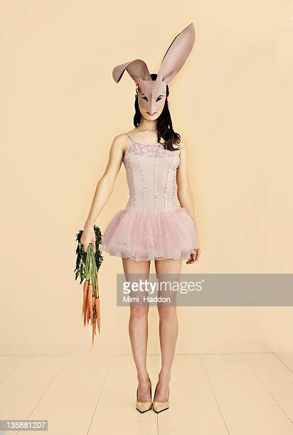 Ballerina Wearing Bunny Mask Holding Carrots