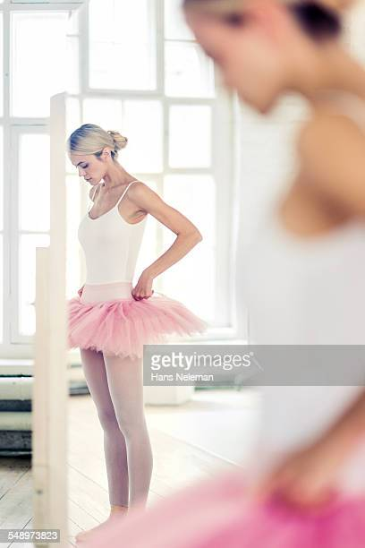 Ballerina wearing tutu during rehearsing in studio
