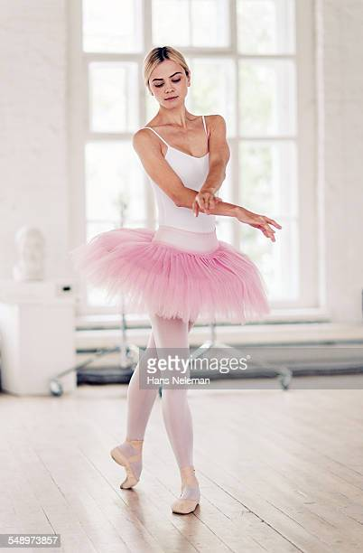 Ballerina wearing tutu during rehearsing in studio