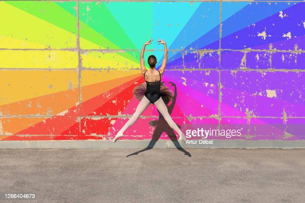 ballerina with black tutu jumping with colorful wall in minimal architecture. - lightweight stock pictures, royalty-free photos & images