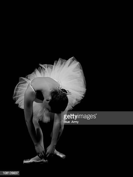 Ballerina Woman Posing Against Black Background