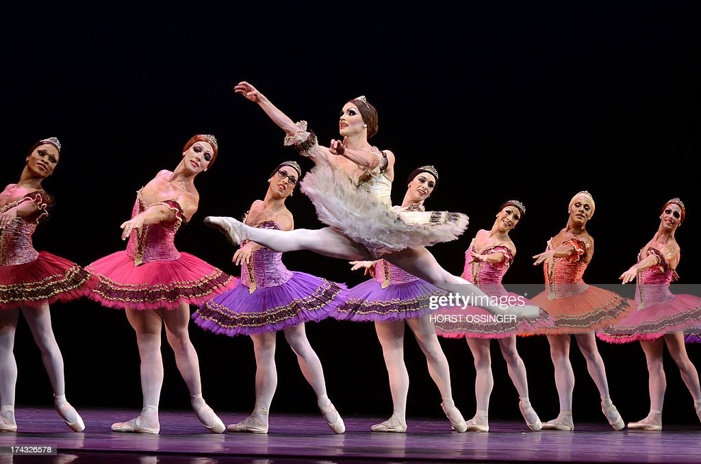 Ballerina Yakaterina Verbosovich (C) of the ballet company 'Les Ballets Trockadero de Monte Carlo' dances during a press call in occasion of the German premiere at the Rhine Opera inDuesseldorf, western Germany, on July 23, 2013. The German Opera on theRhine is hosting the drag ballet group from 23 until 28 July 2013.