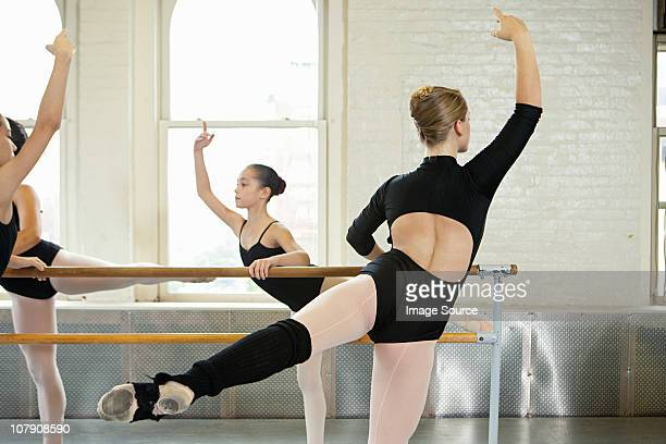 Ballerinas exercising at bar