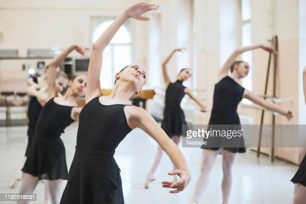 ballerinas in a pose - medium group of people stock pictures, royalty-free photos & images