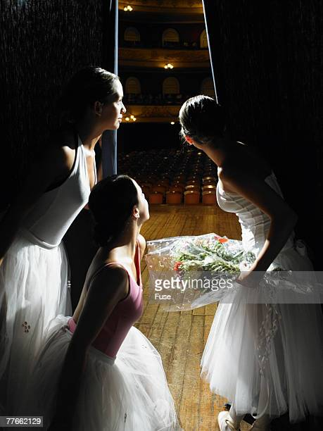 Ballerinas Looking from Behind Curtain