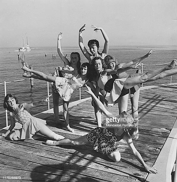 Ballet academy students on a pier in Venice Among them the countesses Carla Nani Mocenigo and Maria Pia Barozzi Venice 1953