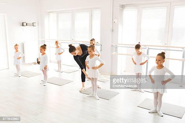 Ballet class in a dance studio.