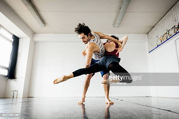 ballet couple perfomring in dance studio