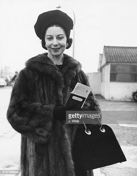 Ballet dancer Alicia Markova, wearing a fur coat and hat, at London Airport, February 24th 1959.