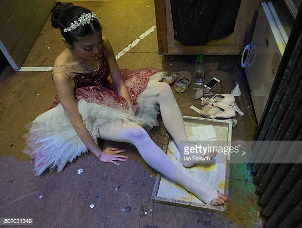 Ballet dancer Ayami Miyata rubs her feet with Rosin to improve friction ahead a performance of The Nutcracker by Northern Ballet at the Grand Theatre...
