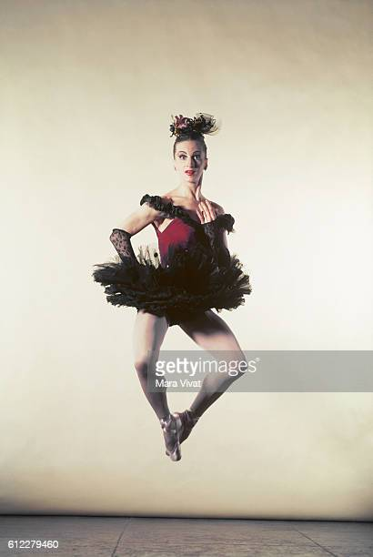 A ballet dancer Beatrice Thompkins jumps wearing a red tutu