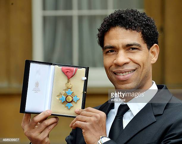 Ballet dancer Carlos Acosta holds his Commander of the Order of the British Empire medal after it was presented to him by the Prince of Wales at the...