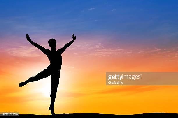 Ballet dancer dancing at dawn