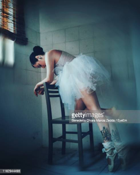 Ballet Dancer Dancing On Chair At Home