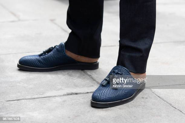 Ballet dancer Eric Underwood wears Kilgor trousers and Christian Louboutin shoes during London Fashion Week Men's on June 10 2018 in London England