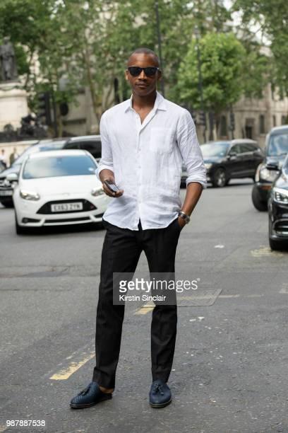 Ballet dancer Eric Underwood wears Kilgor trousers Christian Louboutin shoes Frescobol Carioca shirt and Jimmy Choo sunglasses during London Fashion...