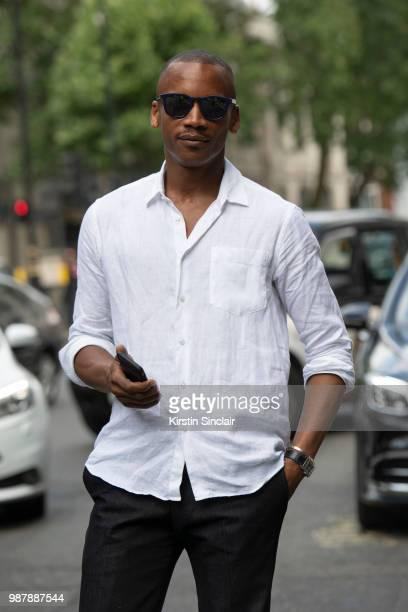 Ballet dancer Eric Underwood wears Kilgor trousers Frescobol Carioca shirt and Jimmy Choo sunglasses during London Fashion Week Men's on June 10 2018...