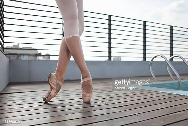 ballet dancer in pointe shoes on sun deck