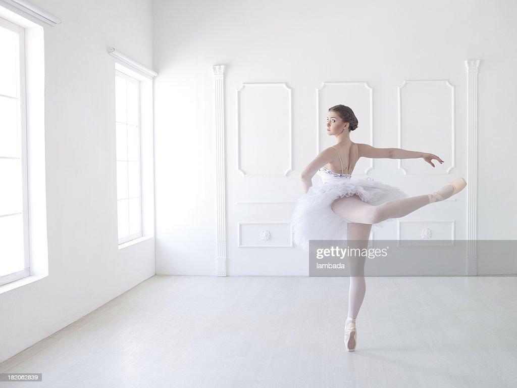 Ballet dancer in white studio : Stock Photo