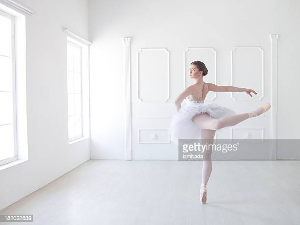 ballet dancer in white studio - ballet dancer stock pictures, royalty-free photos & images