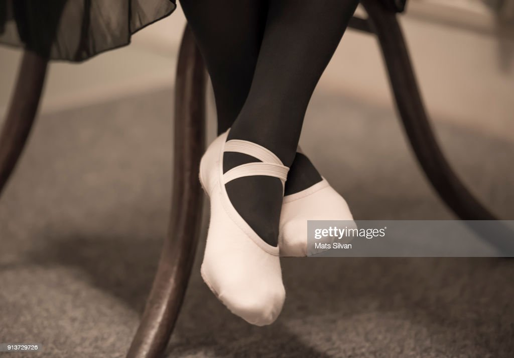 Ballet Dancer Legs With Ballet Shoes Sitting On A Chair : Stock Photo