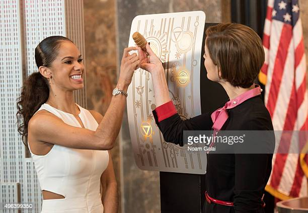 Ballet dancer Misty Copeland and EditorinChief of Glamour Magazine Cindi Leive light the Empire State Building in Honor of the 25th Anniversary of...