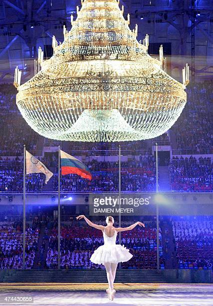 A ballet dancer performs during the Closing Ceremony of the Sochi Winter Olympics on February 23 2014 AFP PHOTO / DAMIEN MEYER