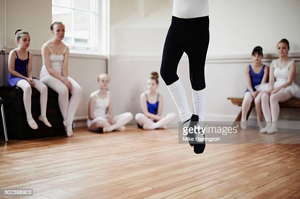 Ballet dancer performs to peers in dance studio