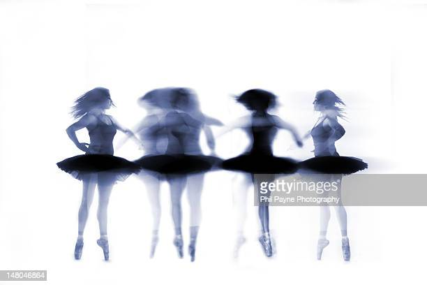 Ballet dancer pirouetting on white