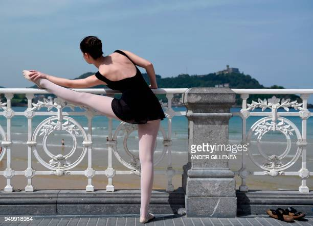A ballet dancer prepares to take part in a classic dance exhibition gathering some 1400 participants to celebrate the Month of The Dance in La Concha...