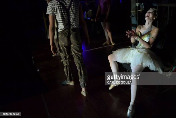 A ballet dancer reacts as dancers perform during a rehearsal before the opening night of a Ballet production at the Municipal Theater in Rio de...