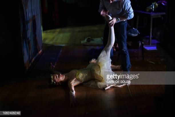 A ballet dancer receives medical treatment during a rehearsal before the opening night of a Ballet production at the Municipal Theater in Rio de...