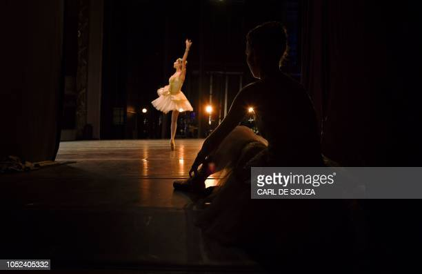 A Ballet dancer rehearses before the opening night of a Ballet production at the Municipal Theater in Rio de Janeiro Brazil on June 19 2018 In 2017...