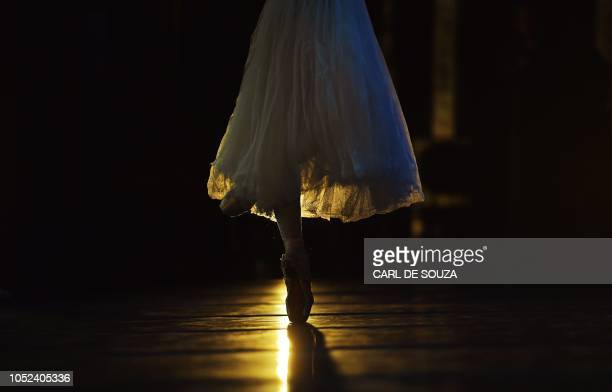 Ballet dancer rehearses before the opening night of a Ballet production at the Municipal Theater in Rio de Janeiro Brazil on June 19 2018 In 2017 the...
