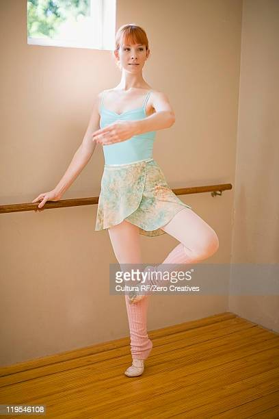 Ballet dancer standing at barre