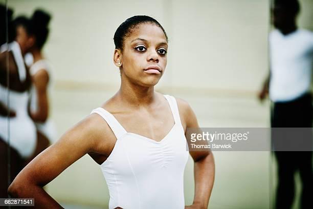 Ballet dancer standing with hands on hips