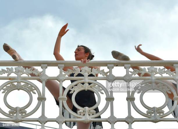 A ballet dancer takes part in a classic dance exhibition gathering some 1400 participants to celebrate the Month of The Dance in La Concha bay in the...