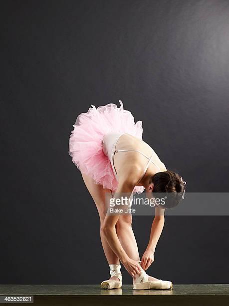 Ballet Dancer Tying Shoe
