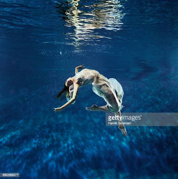 ballet dancer underwater - women wearing see through clothing stock pictures, royalty-free photos & images