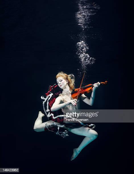ballet dancer underwater with violin