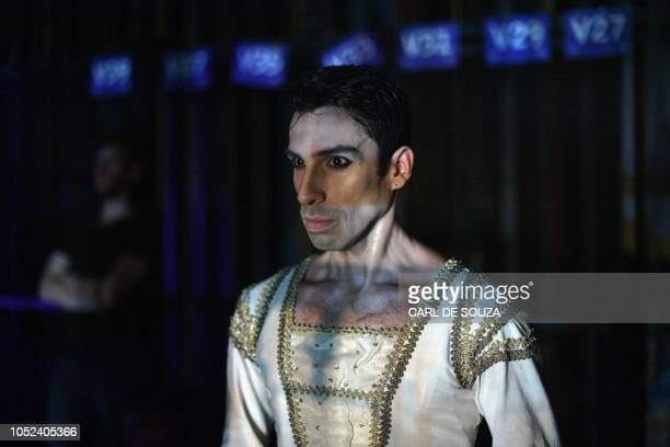 A Ballet dancer watches backstage as his colleagues perform on the opening night of a Ballet production at the Municipal Theater in Rio de Janeiro...