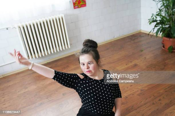 a ballet dancer with down syndrome is rehearsing. - disabilitycollection stock pictures, royalty-free photos & images