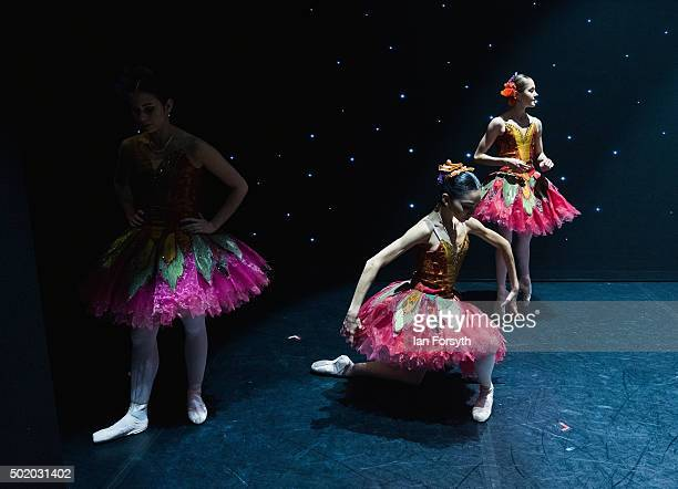 Ballet dancers appearing as snow maidens warm up between acts during a performance of The Nutcracker by Northern Ballet at the Grand Theatre on...