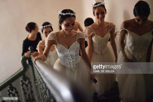 Ballet dancers are pictured before the rehearsal of a Ballet production at the Municipal Theater in Rio de Janeiro Brazil on June 21 2018 In 2017 the...