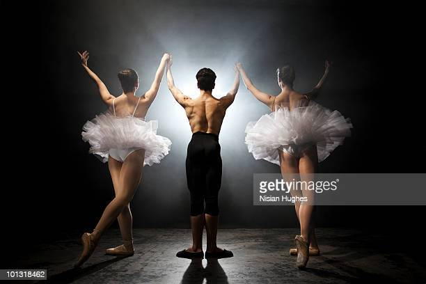 Ballet dancers bowing after performance