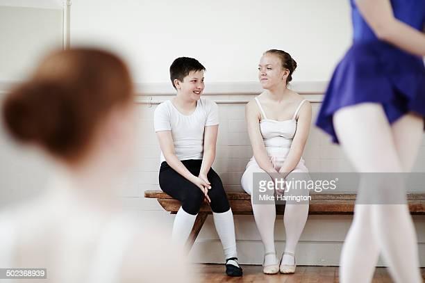 Ballet dancers chatting during break in practise.