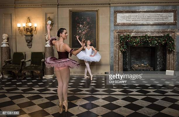 Ballet dancers Daisy Kerry and Alice Rathbone pose in the Painted Hall of Chatsworth House which is decorated for their Christmas season in the theme...